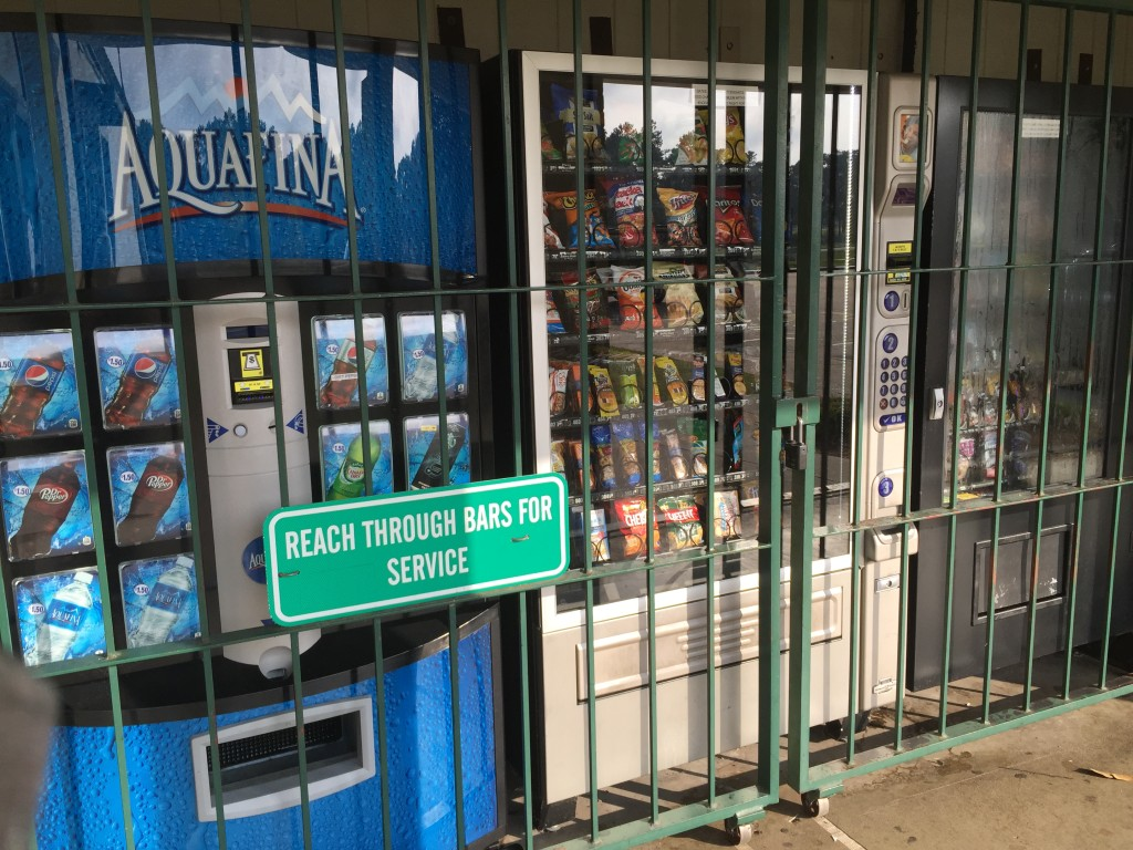 Image of vending machines protected by jail bars