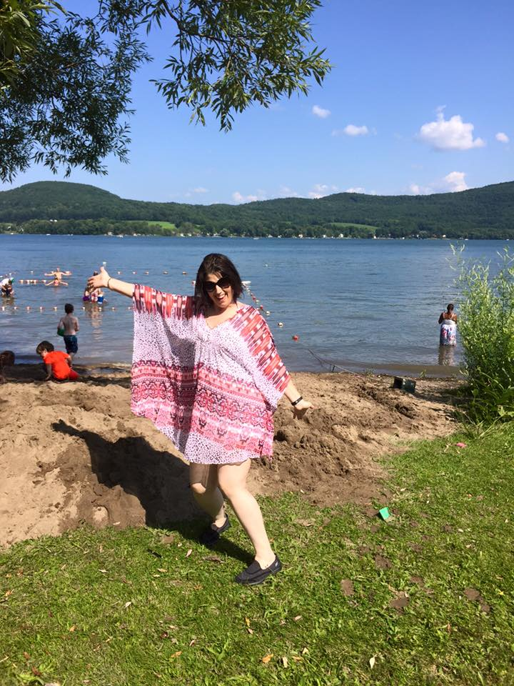 Me, feeling carefree at the small beach on the lake
