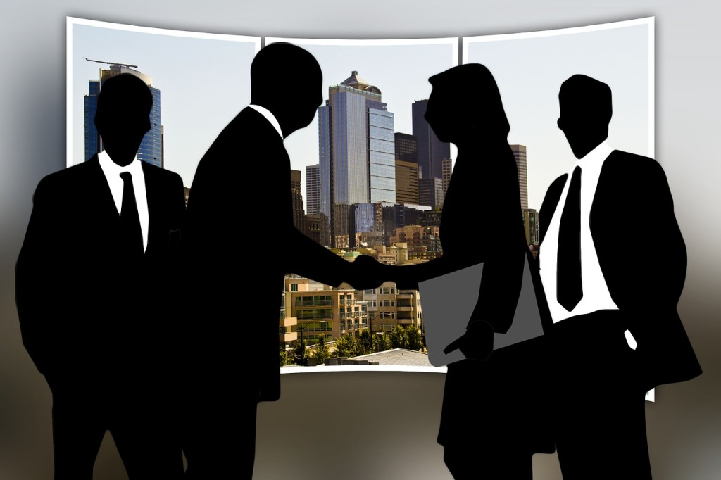 Illustration of Woman and men shaking on a deal.