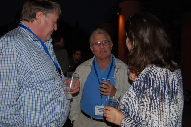 Bill and I talking with a Miva Merchant user in 2011 - Photo by Leslie Kirk