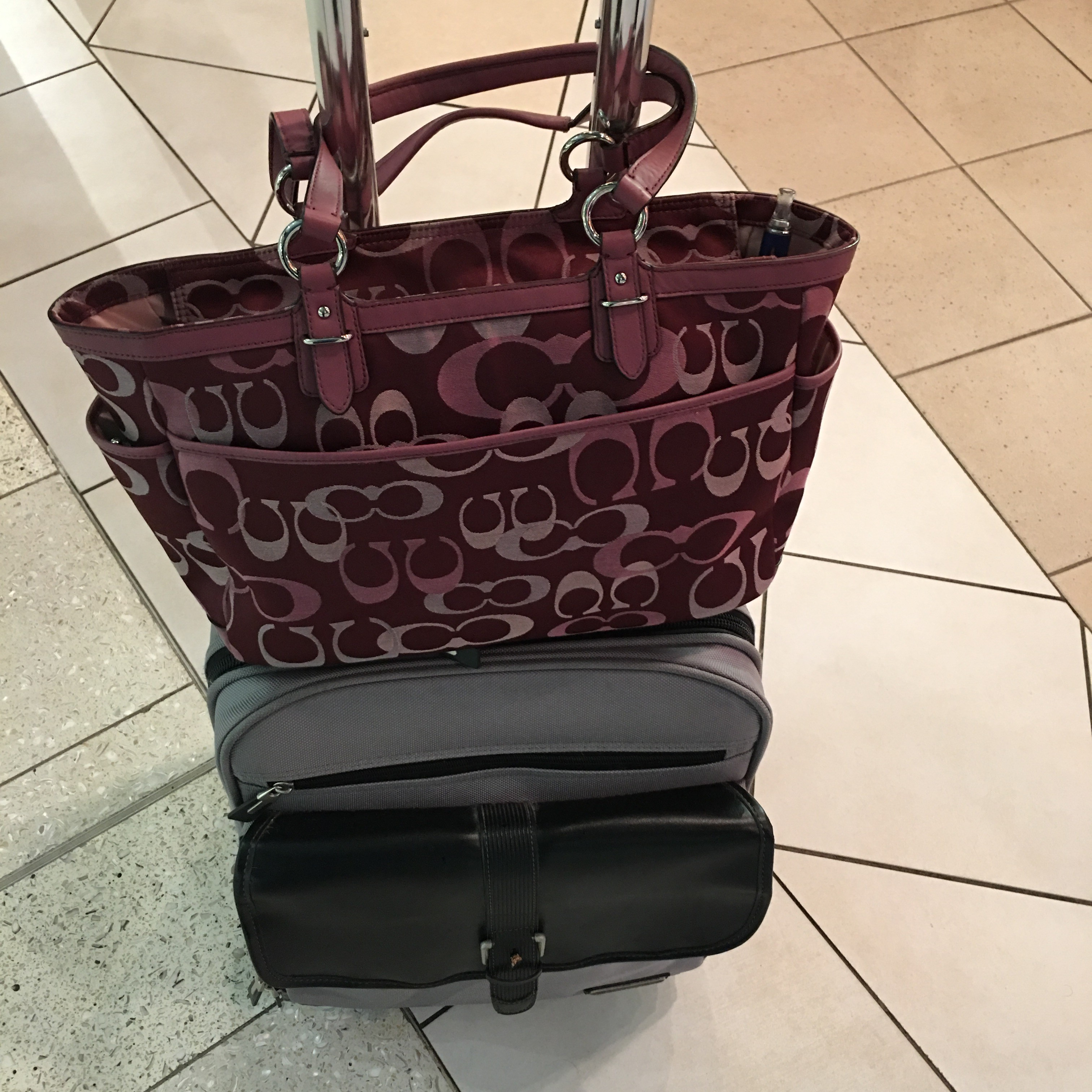 Image of purse and rolling carry-on