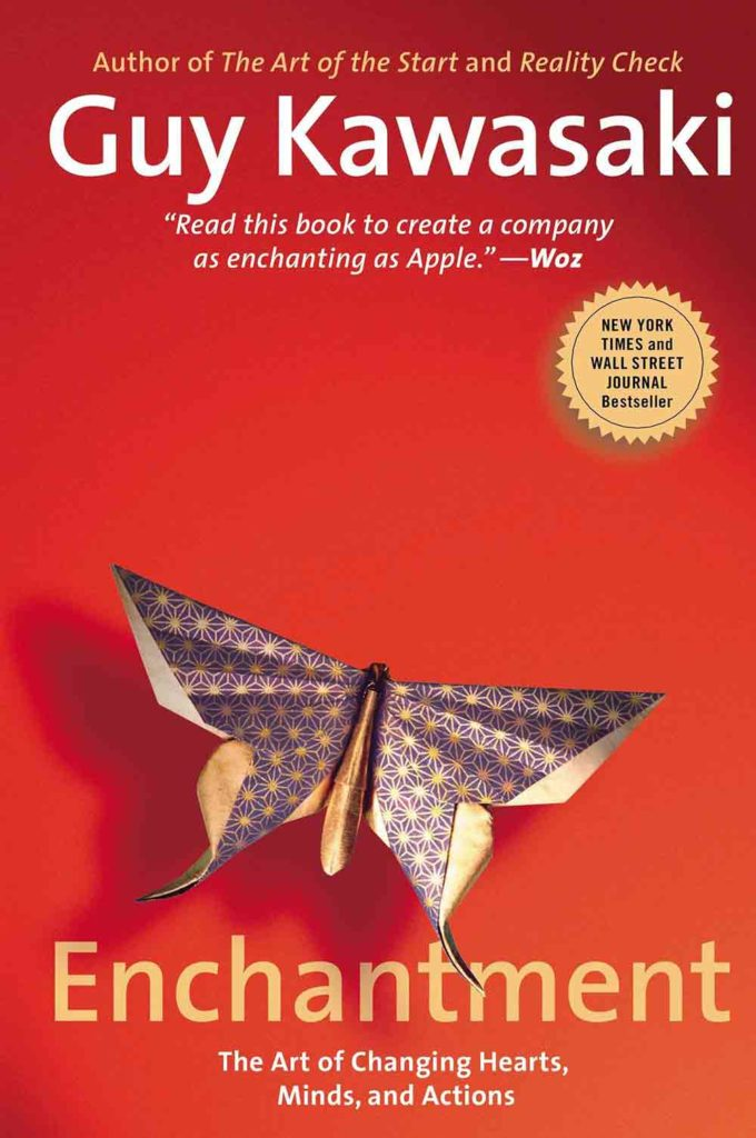 Cover to Guy Kawaki's book, ENCHANTMENT. Red to orange cover with a 3D butterfly.